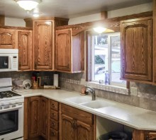 Oak kitchen cabinets, with a medium walnut stain - Fortuna, CA