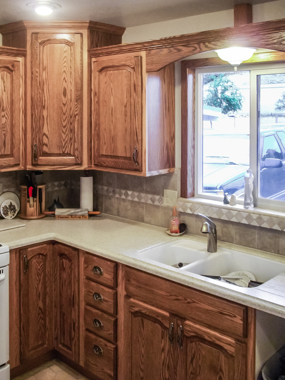 Oak Kitchen Cabinets With A Medium Walnut Stain Fortuna Ca