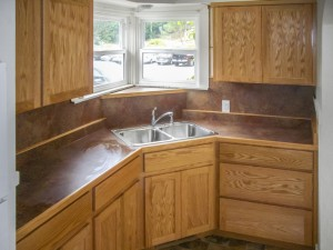 Natural Oak kitchen cabinets with laminate counter - Eureka, CA