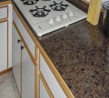 Melamine kitchen cabinets with Oak edging and a laminate counter - Hydesville, CA